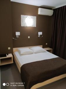 Кровать или кровати в номере Мотель Кировские Дачи