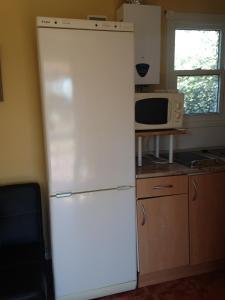 Una cocina o zona de cocina en Camping Cubillas