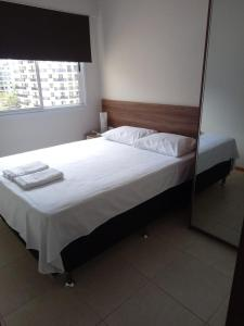 A bed or beds in a room at Apartamento Luxo Barra