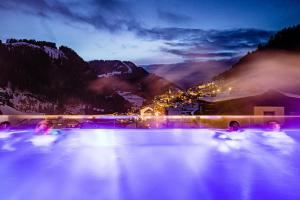 The swimming pool at or near Hotel Touring Dolomites