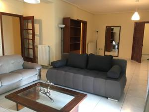 A seating area at Apartments Kanakis 16 Near the Airport Athens