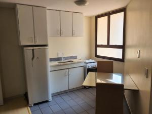 A kitchen or kitchenette at Manhattan Apart Hotel