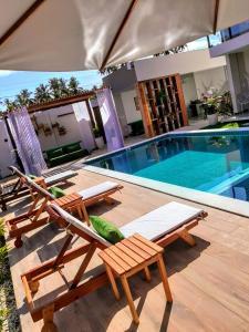 The swimming pool at or close to Pousada Ricoco