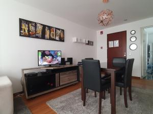 A television and/or entertainment centre at Miraflores 820