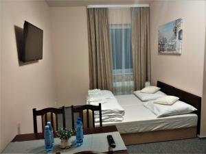 Łóżko lub łóżka w pokoju w obiekcie Zajazd Sum