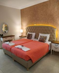Łóżko lub łóżka w pokoju w obiekcie Knights' Castle Studios