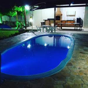 The swimming pool at or close to Solar Recanto da Águia