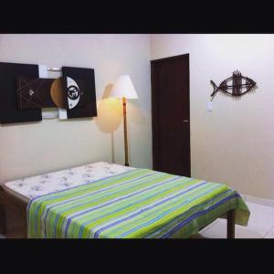 A bed or beds in a room at Pousada Sua Casa