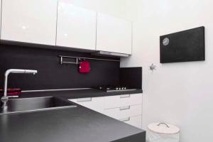 A kitchen or kitchenette at Condominio Dunelba