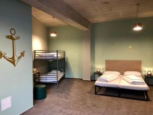A bunk bed or bunk beds in a room at Sandmann Boutique Hostel Hotel