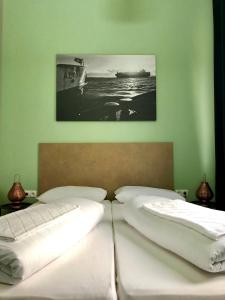 A bed or beds in a room at Sandmann Boutique Hostel Hotel