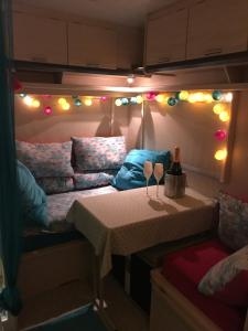 A bed or beds in a room at tuincaravan