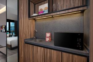 A television and/or entertainment center at Citadines Rochor (SG Clean)