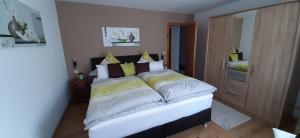 Een bed of bedden in een kamer bij Gästehaus Probst