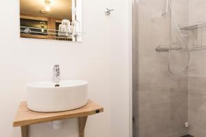 Ett badrum på Åre Torg Hotell