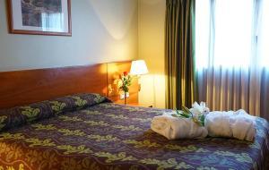 Cama o camas de una habitación en Zenit Diplomatic