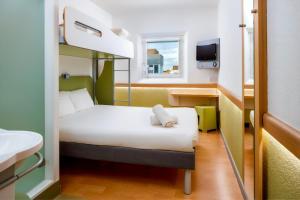Cama o camas de una habitación en ibis budget Manchester Salford Quays