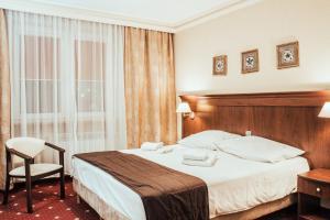 Łóżko lub łóżka w pokoju w obiekcie Cumulus Hotel