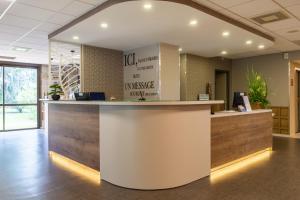 The lobby or reception area at Kyriad Prestige Bordeaux Aeroport