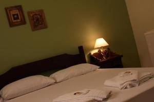 A bed or beds in a room at Pousada Fazenda Sant'Ana