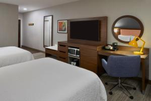 A television and/or entertainment center at Hampton Inn & Suites Montreal-Dorval