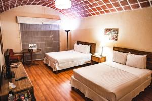A bed or beds in a room at BTH Hotel Arequipa Lake