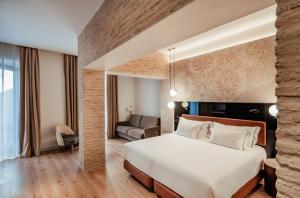 Cama o camas de una habitación en Hotel Unuk