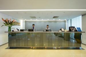 Staff members at Hotel Kapok - Forbidden City