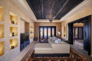 A seating area at Anantara Qasr al Sarab Desert Resort