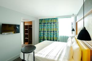 A bed or beds in a room at ibis Styles Leeds City Centre Arena