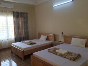 Giường trong phòng chung tại Việt Dũng Motel