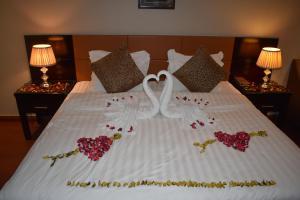 Cama ou camas em um quarto em One to One Grand Marbia