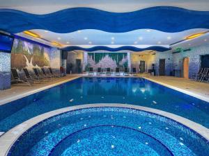 The swimming pool at or near Mercure Corniche Al Khobar