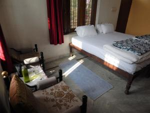 A bed or beds in a room at Vishal Villa
