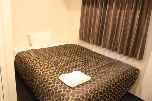 A bed or beds in a room at Hotel Excellence Kyoto Station Hachijo