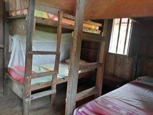 A bunk bed or bunk beds in a room at Casa Majagua La Barra