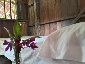 A bed or beds in a room at Casa Majagua La Barra