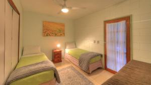 A bed or beds in a room at RiverSong Retreat
