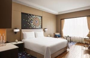 A bed or beds in a room at Taj Hotel & Convention Centre Agra