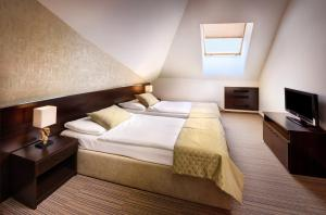 Кровать или кровати в номере Hotel Grand Jasna