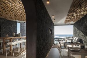 Een restaurant of ander eetgelegenheid bij Kamezí Boutique Hotel Villas