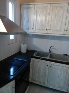 A kitchen or kitchenette at Peiraius Port Rooms