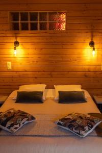 Un ou plusieurs lits dans un hébergement de l'établissement Chalet Anduebis