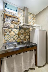 A kitchen or kitchenette at Chalés Santa Catarina