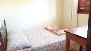 Cama ou camas em um quarto em Nelson's House
