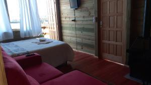 Cama ou camas em um quarto em Chale na Serra Catarinense