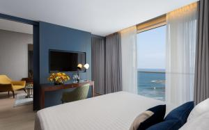 A television and/or entertainment center at Crowne Plaza Tel Aviv Beach, an IHG Hotel
