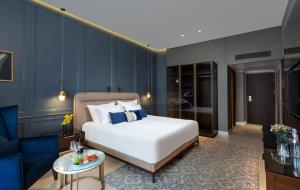 A bed or beds in a room at Crowne Plaza Tel Aviv Beach, an IHG Hotel