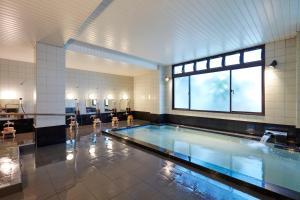 The swimming pool at or near Matsumoto Hotel Kagetsu