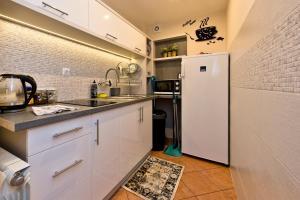 Kuchnia lub aneks kuchenny w obiekcie Pokoje Gościnne Kornelia